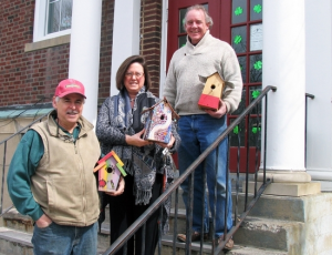 This Saturday, March 23, volunteers will gather at the Warwick Valley Community Center to build birdhouses that will be offered for sale at various locations throughout the village this coming April. From left, contractor Joe Nachtigal of Nightingale Construction, Warwick Valley Community Center Director Karen Thomas and organizer Patrick Gallagher of Gallagher Solar.