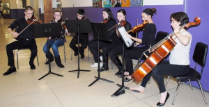 The Warwick Valley School District has been recognized for its commitment to music education with a national Best Communities for Music Education designation. Pictured here are musicians who volunteered to provide music at the high schoolþÄôs recent Empty Bowls fund raiser. There are more than 700 students from grades four through twelve who participate in band or orchestra activities.