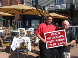 Tony Sylaj, co-owner of Grappa Ristorante, and George Laurence, owner of the Eclectic Eye, invite everyone to come down to Railroad Avenue on Sunday afternoons and Thursday evenings and enjoy Music in the Courtyard.