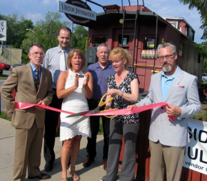 From left, Town of Warwick Supervisor Michael Sweeton, Paul Rafanello, president of the Warwick Valley Chamber of Commerce, Vice President Mechelle Casciotta, Executive Director Michael Johndrow, Kate Case and Mayor Michael Newhard celebrated the opening of Case's new business selling Arbonne products.