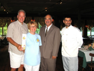 Restaurants, like the Landmark Inn, will use envelopes with information about the program and fundraiser that will accompany a patron's check at the end of the meal. From left, Back Pack Snack Attack volunteer Len Singer holding a coin drop container, President Shirley Puett, Town of Warwick Deputy Supervisor James Gerstner and Michael DiMartino, chef/owner of the Landmark Inn.