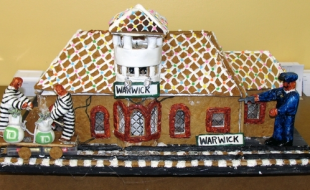 "Last year, judges declared Mike Byro of nearby Hewitt, New Jersey, the winner and recipient of the first-prize award for his gingerbread submission, ""Warwick Train Station""."
