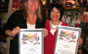"Home for the Holidays co-Chairs Debbie Iurato (left) and Mary Beth Schlichting, hold the new ""Home for the Holidays"" posters that will be displayed throughout the Village of Warwick"