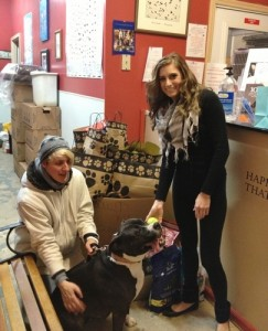 Kayla Scarane, right, owner of Scarlet's Way with Goshen Humane Society volunteer Vaia Mcginnity and Trixie, a sweet and playful 2 to 3-year-old mix breed who is available for adoption.