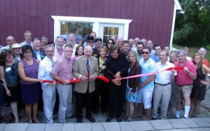 Front from left holding the ribbon at WTBQ, Warwick Valley Chamber of Commerce President Sherry Bukovcan, Mayor Michael Newhard, Town of Warwick Supervisor Michael Sweeton, New York State Senator William Larkin, WTBQ station manager Taylor Sterling and owner Frank Truatt. Some of the other officials pictured in the large group include Orange County Executive Steve Neuhaus, Sheriff Carl DuBois and Warwick Valley Chamber of Commerce Executive Director Michael Johndrow.