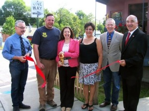 On Wednesday, July 30, Town of Warwick Deputy Supervisor James Gerstner, Mayor Michael Newhard and members of the Warwick Valley Chamber of Commerce Board of Directors joined founder Meg Peterson and her husband, Steve, for a ribbon-cutting ceremony to introduce their business to the Warwick community.