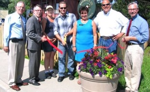 From left, Warwick Valley Chamber of Commerce Executive Director Michael Johndrow, Town of Warwick Supervisor Michael Sweeton, Protection Fence Managers Maria Lagasse and her brother Joe Moocz Jr., Chamber President Sherry Bukovcan, Board member Wayne Patterson and Mayor Michael Newhard.