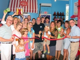 On Aug. 27, public officials as well as chamber representatives joined owner Adam Powers, his family and staff for the grand opening of Fizzy Lifting Soda Pop Candy Shop. Owner Adam Powers (center), surrounded by family, friends, staff and members of the Warwick Valley Chamber of Commerce cuts the ribbon held by Mayor Michael Newhard (left) and Town of Warwick Supervisor Michael Sweeton (right).