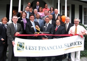 On Oct. 2, public officials and members of the Warwick Valley Chamber joined founding partners Robert Cepeda and Nicholas Tuck and their advisors and staff for the grand opening of their new office in a former Victorian home at 11 Oakland Ave. Town of Warwick Supervisor Michael Sweeton (left) and Mayor Michael Newhard (right) holds the ribbon being cut by Nickolas Tuck standing alongside Robert Cepeda.