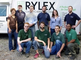 Rylex Custom Cabinetry & Closets group photo, beginning in the top row, from left to right: Dawn Ferrec, Lee Ferrec, John Lashuay, Bryan Sullivan, Janelle Garguillo and Chris Reymaniak; and in front: Austin Kavanaugh, Alex Ferrec, Dan Lewis and Glenn Henry.