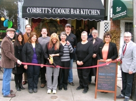 On Oct. 31, Town of Warwick Supervisor Michael Sweeton (far left), Mayor Michael Newhard (far right) and members of the Warwick Valley Chamber of Commerce joined Cheryl Corbett (center) and her friends for a ribbon-cutting ceremony to celebrate the grand opening of CorbettþÄôs Cookie Bar Kitchen at 12 Railroad Ave. in the Village of Warwick.