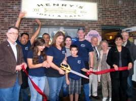 On Thursday, Nov. 6, owners Karen and Philip McKenna, their family, friends and staff celebrated the grand opening of HenryþÄôs Deli & Caf‡©. From left, Town of Warwick Supervisor Michael Sweeton, employee Guillermo Jimenez, daughter Maeve McKenna, employee Miguel Chinas, co-owner Karen McKenna (cutting ribbon), daughter Fiona McKenna, son Henry McKenna, co-owner Philip McKenna, friends Patrick and Anita Colman, Sherry Bukovcan, president of the Warwick Valley Chamber of Commerce and Chamber Executive Director Michael A. Johndrow. Not present for the photo employee Dylan Hummer.
