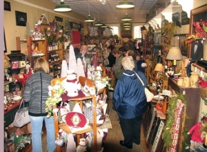 Visitors crowded downtown shops, many of which were decorated for the season and offering þÄúopen houseþÄù events with free refreshments and special offers. Pictured here is Frazzleberries.