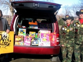 On Monday, Dec. 15, WTBQ owner Frank Truitt, Station Manager Taylor Sterling and Frank þÄúUncle BuckþÄù Pileggi, co-host of the Thursday þÄúFrank Truitt Morning Show,þÄù presented a carload of toys to Pete and Laura Rollins, co-founders of Goshen Chapter 212, Disabled American Veterans. From left, WTBQ Station Manager Taylor Sterling, owner Frank Truitt, Laura and Pete Rollins and Frank þÄúUncle BuckþÄù Pileggi.