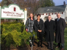 On Nov. 25, Town of Warwick Supervisor Michael Sweeton, Sherry Bukovcan, president of the Warwick Valley Chamber of Commerce, and Chamber Executive Director Michael Sweeton joined owner and innkeeper Loretta Breedveld to celebrate the installation of her new custom designed sign.