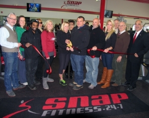 On Jan. 8, Town of Warwick Deputy Supervisor James Gerstner (far right), Mayor Michael Newhard (far left) and members of the Warwick Valley Chamber of Commerce Board of Directors joined co-owners Shari McAtee-Caruso and her husband, Jim Caruso (center)and their staff for the official grand opening of the Snap Fitness new location in Warwick.