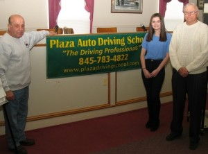 From left: Charlie LaVerdi, owner of Plaza Auto Driving School, Mackenzie Kolman who successfully completed her five-hour pre-licensing course and also her road test and retired Warwick Police Sgt. George Arnott.