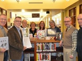 Pictured here at the library display of taekwondo books are Warwick Valley Chamber of Commerce Director, Michael Johndrow, Warwick town Supervisor Michael Sweeton, Chosun Taekwondo Academy instructor Jake Garrett,  Chosun Taekwondo Academy Yoga Director Patty Cook, Chosun Taekwondo Academy instructor Pamela Pyke, Albert Wisner Library Director Rosemary Cooper, Village of Warwick Mayor Michael Newhard and Chosun Taekwondo Academy owner Master Doug Cook.