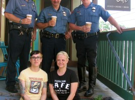 On Tuesday morning, May 12, local residents were invited to have þÄúCoffee with a Cop,þÄù at the Tuscan Caf‡© on South Street in the Village of Warwick. Front from left, Tuscan Caf‡© co-owners Kristen Ciliberti and Cristie Ranieri. Standing rear from left, Warwick Police Lt. Tom Maslanka, Lt. John Rader and Chief Thomas McGovern Jr.