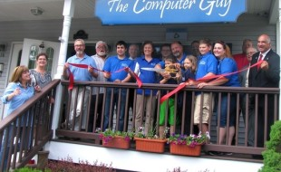 "Photo by Roger Gavan On Friday, June 5, Town of Warwick Deputy Supervisor James Gerstner, Mayor Michael Newhard and members of the Warwick Valley Chamber of Commerce joined owner Kevin Brand, his family and staff for a ribbon-cutting ceremony to celebrate five successful years of ""The Computer Guy,"" at 17 West St. in the Village of Warwick."