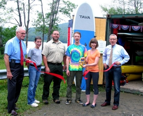 Photo by Roger Gavan On July 9, government and business representatives joined owners Chaz Corallo and Theresa Sparkes for the grand reopening of Greenwood Lake Paddleboards at its new location at Monksville's South Launch. From left, Ringwood Mayor Walter Davison, Ringwood Chamber of Commerce Vice President of Membership Patti Hoffmann, Ringwood State Park Superintendent Eric Pain, owners Chaz Corallo and Theresa Sparkes and Michael Johndrow, executive director of the Warwick Valley Chamber of Commerce.