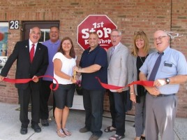 From left, Town of Warwick Deputy Supervisor James Gerstner, Warwick Valley Chamber of Commerce Board member Wayne Paterson, owner Linda Roman and her husband, David, Chamber Executive Director Michael Johndrow, Board member Karen Burke and Chamber President Doug Stage celebrate the grand opening of 1st Stop Kids Shop in Merchant Square.