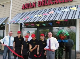Photo by Roger Gavan On Monday, July 27, Town of Warwick Supervisor Michael Sweeton (far right) and Michael Johndrow (far left), executive director of the Warwick Valley Chamber of Commerce, joined owner Benny Yang (center), his staff and media consultant Chris Olert (rear) for the grand opening of Asian Delicacies at 148 Route 94-South in the Price Chopper complex.