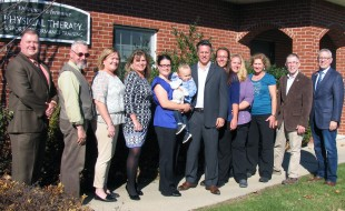 Photo by Roger Gavan On Nov. 4, Town of Warwick Supervisor Michael Sweeton (far right), Mayor Michael Newhard (second from left) and members of the Warwick Valley Chamber of Commerce joined Dr. Rick Rutkowski (center) and his staff to celebrate the 15th anniversary of Optimum Performance Physical Therapy.
