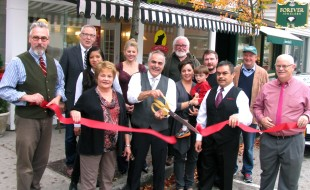 Photo by Roger Gavan On Nov. 5, Mayor Michael Newhard (far left), Warwick Valley Chamber of Commerce President Doug Stage (far right) and members of the Chamber Board of Directors joined Moshe Schwartzberg (center), his family, staff and friends for the grand opening of Wolfies of Warwick.