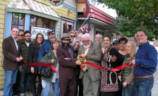 Photo by Roger Gavan On Monday, Nov. 2, Town of Warwick Supervisor Michael Sweeton, Greenwood Lake Mayor Jesse Dwyer, members of the Warwick Valley and Greenwood Lake chambers of commerce and relatives, friends and supporters joined Thomas Roberts and Joseph Justin for the grand opening of the second Ye Olde Warwick Book Shoppe in Greenwood Lake.