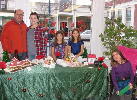 """The winners of the 2015 Gingerbread Contests from left, Bridget DeHaan and her father, Chris DeHaan, Caterina """"Cat"""" Pleva, 9, and her friend Brooke Lamb, 9, and Kellie Cusack."""
