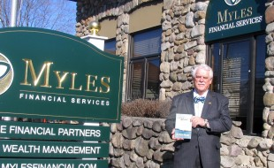 """Photo by Roger Gavan Vince Mezzetti holds his new book, """"Crossing the Bar: My Life, Changes, Challenges, Choices,"""" outside the Myles Wealth Management building in the Village of Florida. -"""