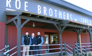 Photo by Roger Gavan Arnold Bieling (center) flanked by his sons and co-owners Tim (left) and Scott (right) outside Roe Brothers Lumber in the Village of Florida. The company is celebrating its 130th year of doing business.