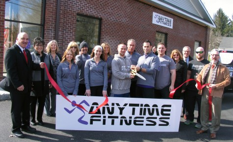 Photo by Roger Gavan On Monday, March 7, Town of Warwick Deputy Supervisor James Gerstner (far left), Mayor Michael Newhard (far right) and members of the Warwick Valley Chamber of Commerce joined the Klein family (center), owners of Anytime Fitness, and their staff for an official grand opening ribbon-cutting.