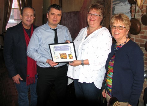 Photo by Roger Gavan As a special token of appreciation this year, Grappa Ristorante was recognized for its longtime support of the Back Pack Snack Attack. From left, committee member John Desibia, Grappa partner Nick Ahmetaj, committee member Mary Schweitzer and Shirley Puett, director of Back Pack Snack Attack. Tony Sylaj, owner of Grappa Ristorante, was not available for the photo.