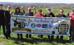 """Photo by Roger Gavan On Saturday, May 28, Pennings Farm, 161 Route 94 in Warwick, will present """"A Brew with a View"""" at the fifth annual Brewfest on the Farm. Owner Steve Pennings (far right) poses in the orchard with his department heads and staff."""