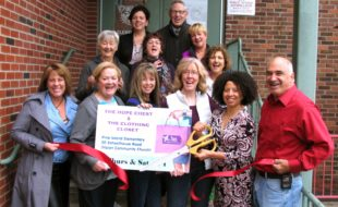 Photo by Roger Gavan On Thursday, May 5, Town of Warwick Deputy Supervisor James Gerstner (far right) and members of the Warwick Valley Chamber of Commerce joined Director Sylvia Diaz (cutting ribbon) and founders and members of the Hope Chest Thrift Boutique, The Clothing Closet and Treasure Chest to celebrate their fifth year of helping support neighbors in need by giving away free clothing.