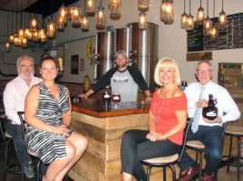 Photo by Roger Gavan Seated around the bar with Pine Island Brewery owner Mike Kraai (behind the bar) are, from left, Warwick Valley Chamber of Commerce Programs Committee members John Redman, Kristen Weiss, Janine Dethmers and Executive Director Michael Johndrow.