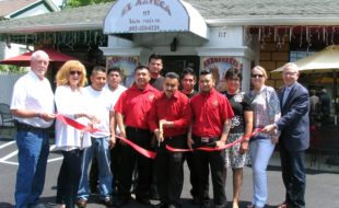 Photo by Roger Gavan On Wednesday, May 25, Florida Deputy Mayor Tom Fuller (left), also representing the Florida Chamber of Commerce, and members of the Warwick Valley Chamber of Commerce joined Bernardino Morales (center) and his staff to celebrate the ninth anniversary of El Azteca II Mexican restaurant at 117 South Main St. in the Village of Florida.