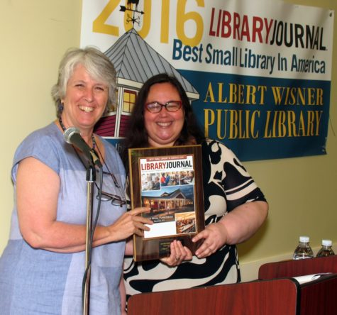 Photo by Roger Gavan The award was presented to Library Director Rosemary Cooper (left) by Meredith Schwartz, editor of Library Journal Magazine.