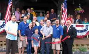 Photo by Roger Gavan On Friday, June 3, local officials and representatives of the Florida and Warwick Chambers of Commerce joined the owners, their families, staff and customers for a ribbon-cutting ceremony to celebrate the grand reopening of Roe Brothers Lumber on Maple Avenue in the Vilalge of Florida. Arnold Bieling (center), flanked by his sons and co-owners Scott (left) and Tim (right) and their families, cuts the ribbon held by Florida Mayor James Pawliczek (far left) and Town of Warwick Deputy Supervisor James Gerstner (far right.)
