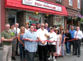 hoto by Roger Gavan On Monday, June 27, Town of Warwick Supervisor Michael Sweeton (far right), Mayor Michael Newhard (far left) and members of the Warwick Valley Chamber of Commerce joined owners Frank and Matt Rinaldi (center), their families, friends and staff for a ribbon-cutting ceremony to celebrate the 40th anniversary of the family pizzeria.