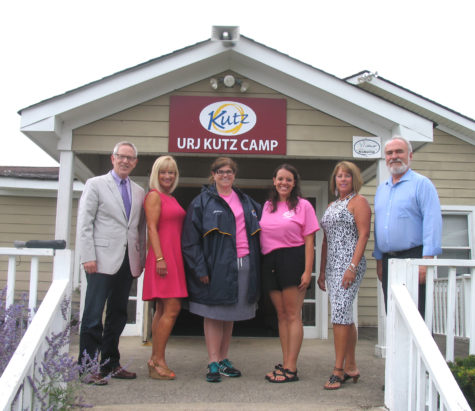 "Photo by Roger Gavan Gathered at the front entrance of URJ Kutz Camp for The Warwick Valley Chamber of Commerce Aug. 31 '""Endless Summer Business Mixer"" are, from left: Warwick Valley Chamber of Commerce Executive Director Michael Johndrow, Event Chair Janine Dethmers, Kutz Camp Director Melissa Frey, Retreats On-Site Coordinator Joanna Falk, Warwick Valley Chamber of Commerce President Mechelle Casciotta and Vice President John Redman."