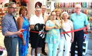 "Photo by Bea Arner On July 27, village officials and chamber representatives joined Diva Dog Pet Boutique & Barkery owner Francesca Pou and her family to celebrate the store's grand opening at its new location. From left, Mayor Michael Newhard, Warwick Valley Chamber of Commerce President Mechelle Casciotta, Hector Pou holding ""Minnie,"" Chamber Executive Director Michael Johndrow, owner Francesca Pou, Chamber Board member Caryn Burke, Maria Pou and Village of Warwick Deputy Mayor and Orange County Legislator Barry Cheney."