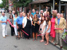 Photo by Roger Gavan On Thursday, August 11, Mayor Michael Newhard (far left), Town of Warwick Supervisor Michael Sweeton (far right) and members of the Warwick Valley Chamber of Commerce joined co-owner Nicole Repose (center), her family, staff and friends, to celebrate the grand opening of their newly remodeled and expanded store.