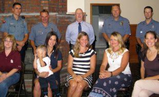 """Photo by Katie Bisaro Gearing up for the upcoming """"Coffee with a Cop"""" event (seated, from left) are: Jennifer Santoro, manager of Dunkin' Donuts in Warwick, the administrators of The Warwick, NY Parents Group - Kristin Meola with her son, Levi, Kerri Fenton Foley, Nicole McCormick and Megan Cardenas; and standing, from left to right from the Warwick Police Department are: Officer Brian Luthin, Lt. John Rader, Chief Thomas McGovern, Lt. Thomas Maslanka and Officer John Harter."""