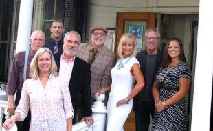 """Photo by Roger Gavan Lined up on the front porch at The Dautaj Restaurant to finalize plans for the Warwick Valley Chamber of Commerce Oct. 19 """"Style for Fall"""" fashion show and business mixer are, beginning rear from left: Ray Townley and Val Berisha of The Dautaj and Style Counsel and Blue owner Tim Mullally; and in front, from left: chamber members Kim Starks, John Redman, Janine Dethmers, Michale Johndrow, and Kristen Weiss."""