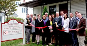 Photo by Bea Arner On Thursday, Sept. 29, Town of Warwick Supervisor Michael Sweeton (far right), Orange County Legislator Barry Cheney (rear, second from left), Mayor Michael Newhard (far left) and members of the Warwick Valley Chamber of Commerce joined Quest Financial Services manager Ken Flood and his staff for the grand opening of their new office at 7 Grand St.