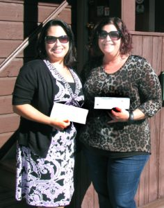 Photo by Roger Gavan On Oct. 19, Corrine Iurato (right), chair of Ladies Night Out, presented Stephanie Molinelli, residential services director for Safe Homes of Orange County, with checks totaling $1,200 - proceeds from the annual event.