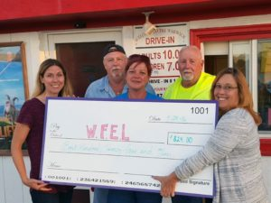 Provided photos On Sept. 23, the Warwick Foundation for Excellence in Learning held its third annual event at the Warwick Drive-In. More than 200 people attended the family-favorite event; 40 percent of each ticket admission was donated to WFEL. Pictured here with the ceremonial check are, from left to right: Vanessa Holland, Al Royce, Sam Cottrell, Tom Fuller and Beth Wilson.